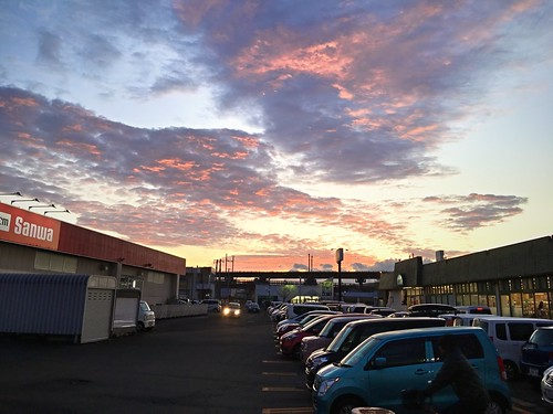 24november2019 edited kitahiroshima hokkaido japan railcrossing parkinglot grocerystore sunset clouds sky cars
