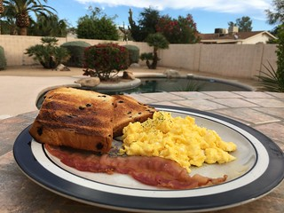 Good Morning. Scrambled Eggs, Bacon, Brioche Loaf w/Chocolate Chips, Butter
