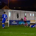 Declan Milne (grounded) slides in to score the winner