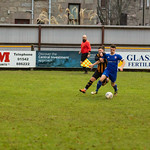 Paul Esslemont puts Lossiemouth captain Liam Archibald under pressure