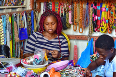 Waist beads are very popular in Ghana.  These ladies spend all day making them, and they can be quite time-consuming to string together!