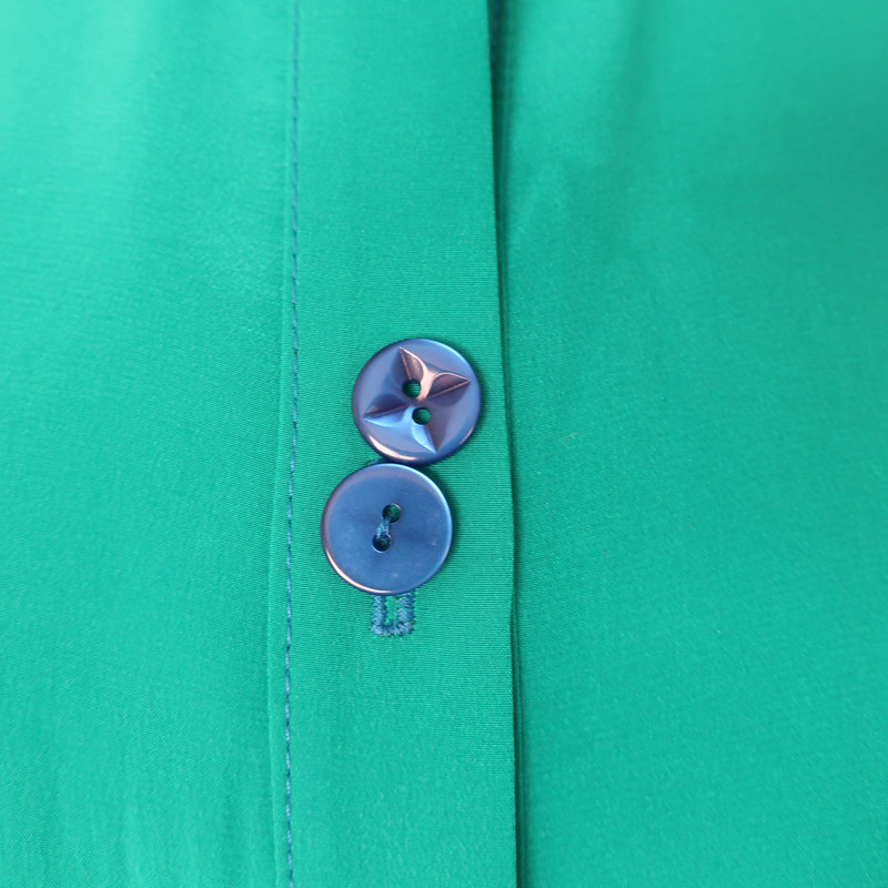 green shirt buttons