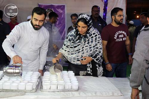 Satguru Mata Ji distributing Milk for Devotees