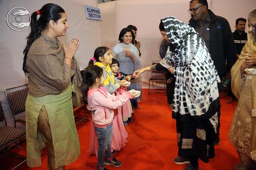 Children offering sweets