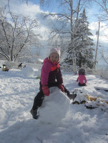 sitting on her snowball