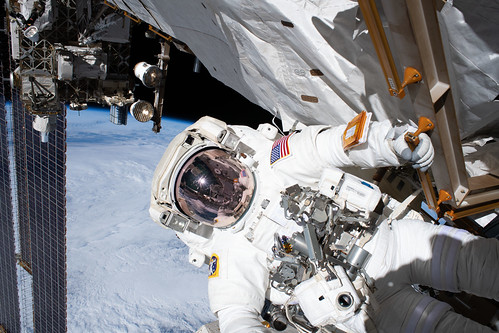 Astronaut Andrew Morgan holds on to a handrail | by NASA Johnson