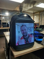 Jim's face on an LED backpack.