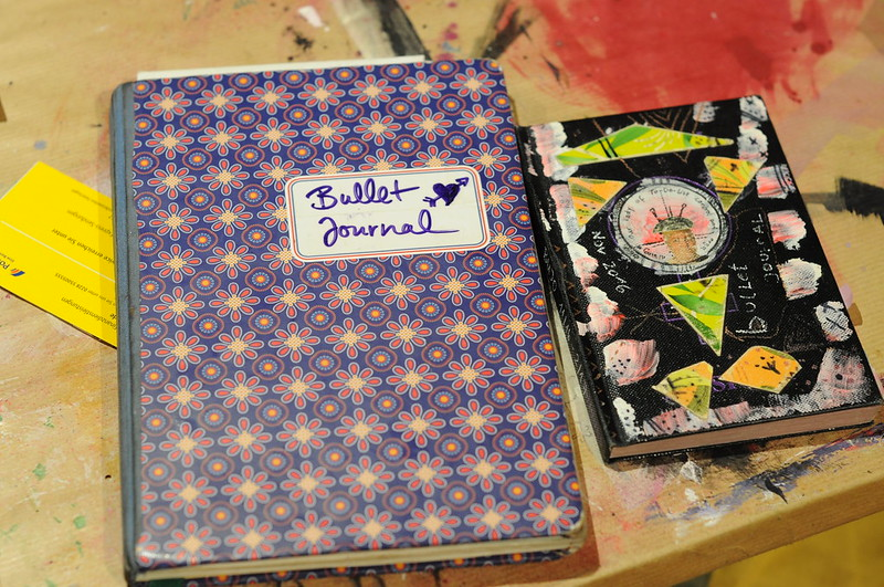two bullet journals side by side - my first one and my current one. Bulletjournaling November 2016 - November 2019