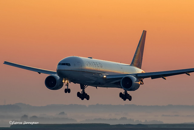 United Airlines Boeing B767 landing during sunrise