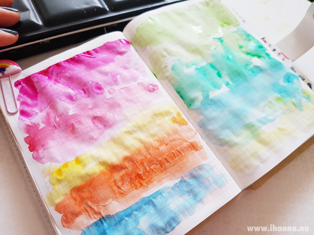 Crinckly paper under rainbow of watercolors painted by iHanna