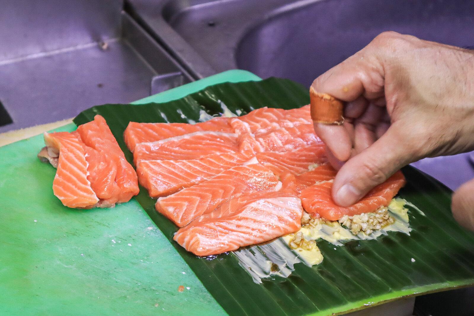 placing salmon on leaf 2