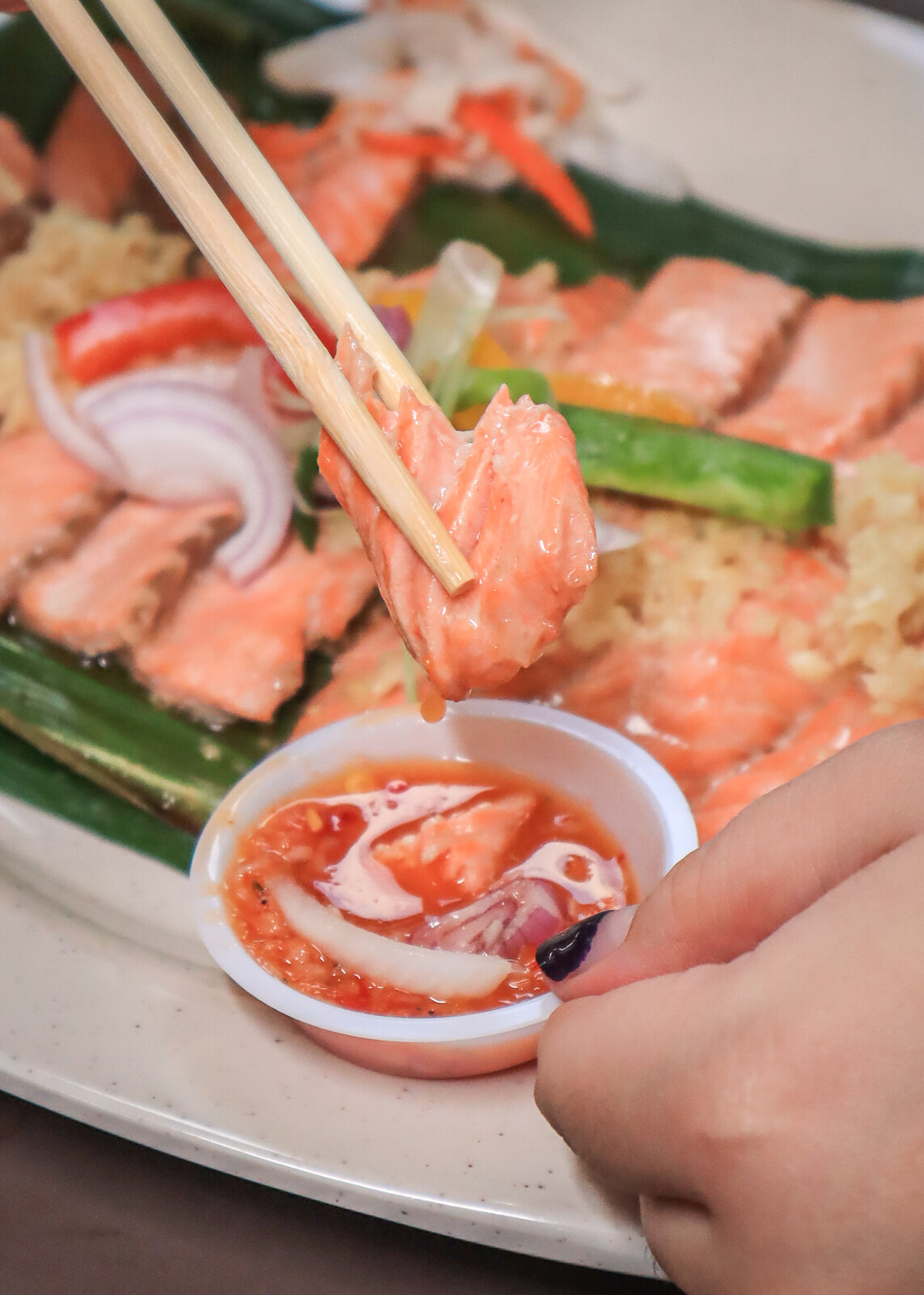 dipping salmon in chilli