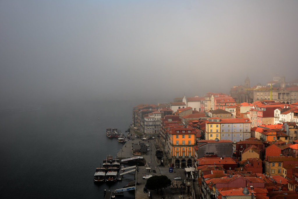 The fog begins to dissipate over old city