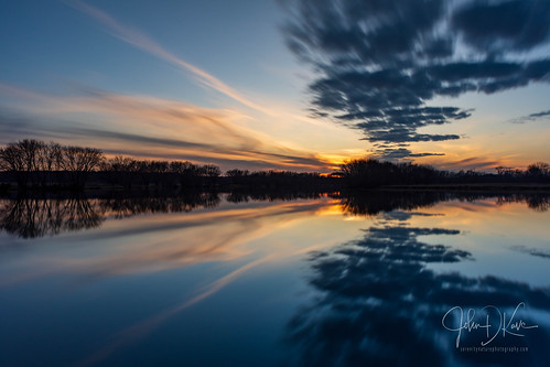 A sprinkling of dramatic clouds makes for a nice sunset along the Fox River in northern Illinois