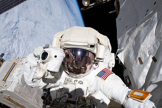 NASA astronaut and spacewalker Andrew Morgan prepares to take a photograph | by NASA Johnson