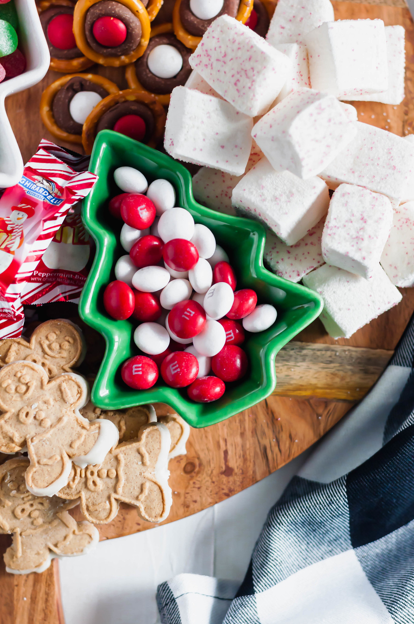 This Easy Christmas Dessert Board will be the talk of your Christmas party. A homemade treat or two filled in with fun, festive cookies and candies.