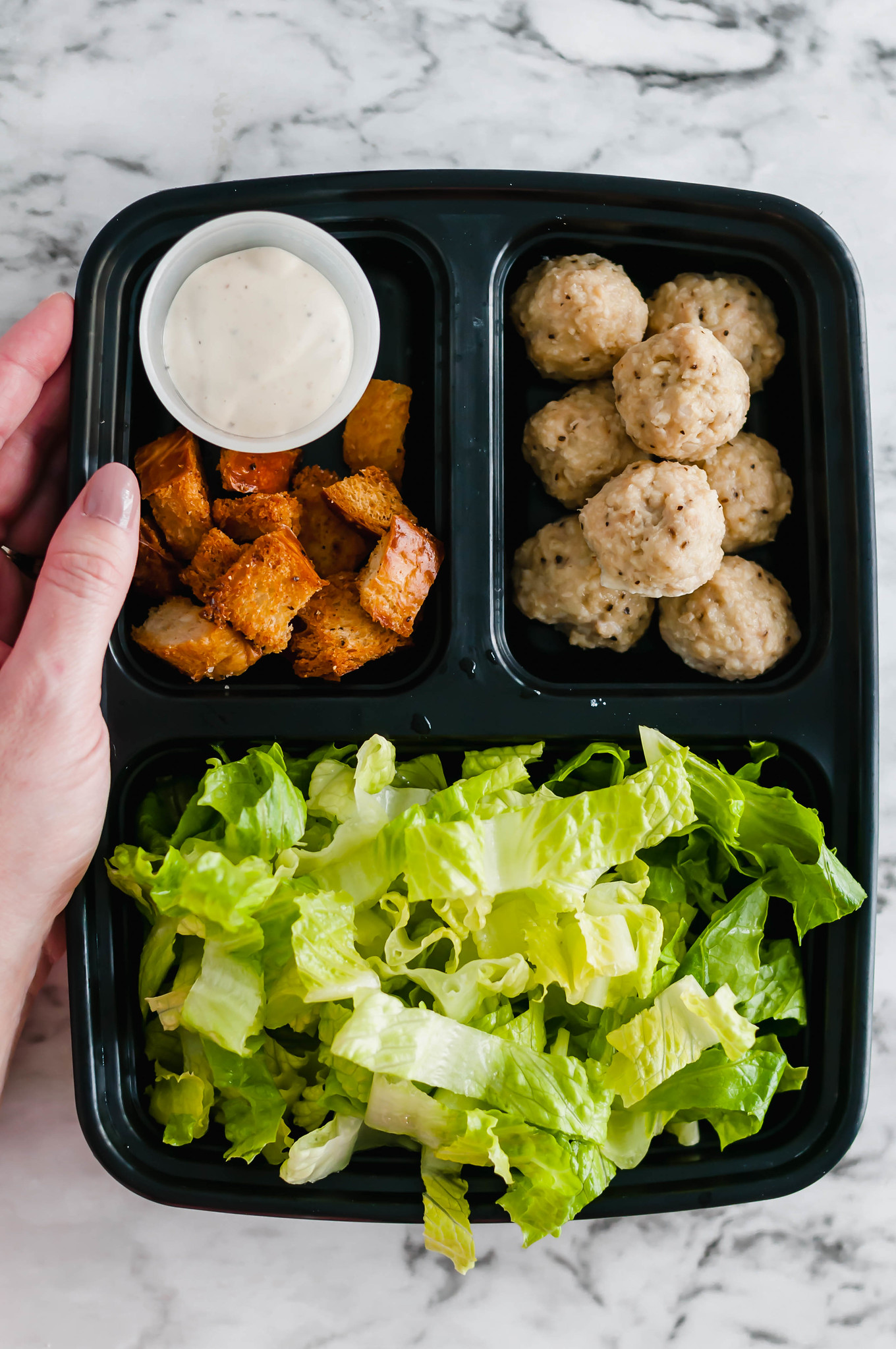 Salad Meal Prep is the perfect way to start out your New Year healthy. 45 minutes of prep results in a weeks worth of healthy and delicious lunches. Caesar dressing, homemade croutons and mini chicken meatballs add lots of flavor to the mix.