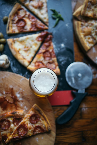 Light beer in glass and  Italian pizza in the restaurant. | by shixart1985