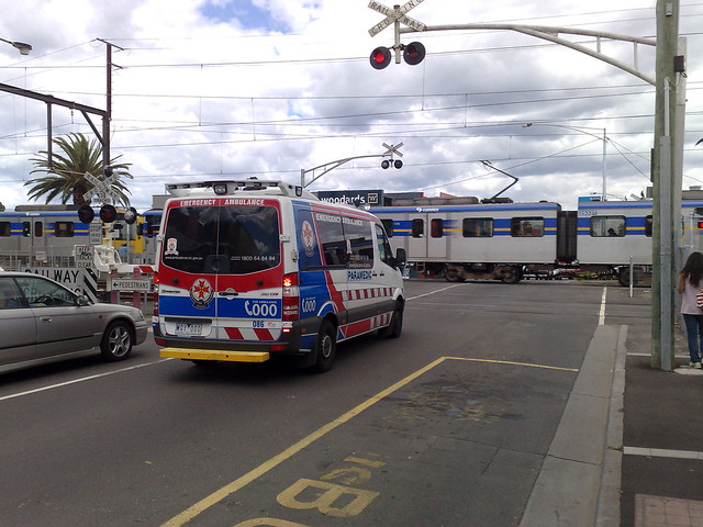 Ambulance waiting for a train, Bentleigh, November 2009