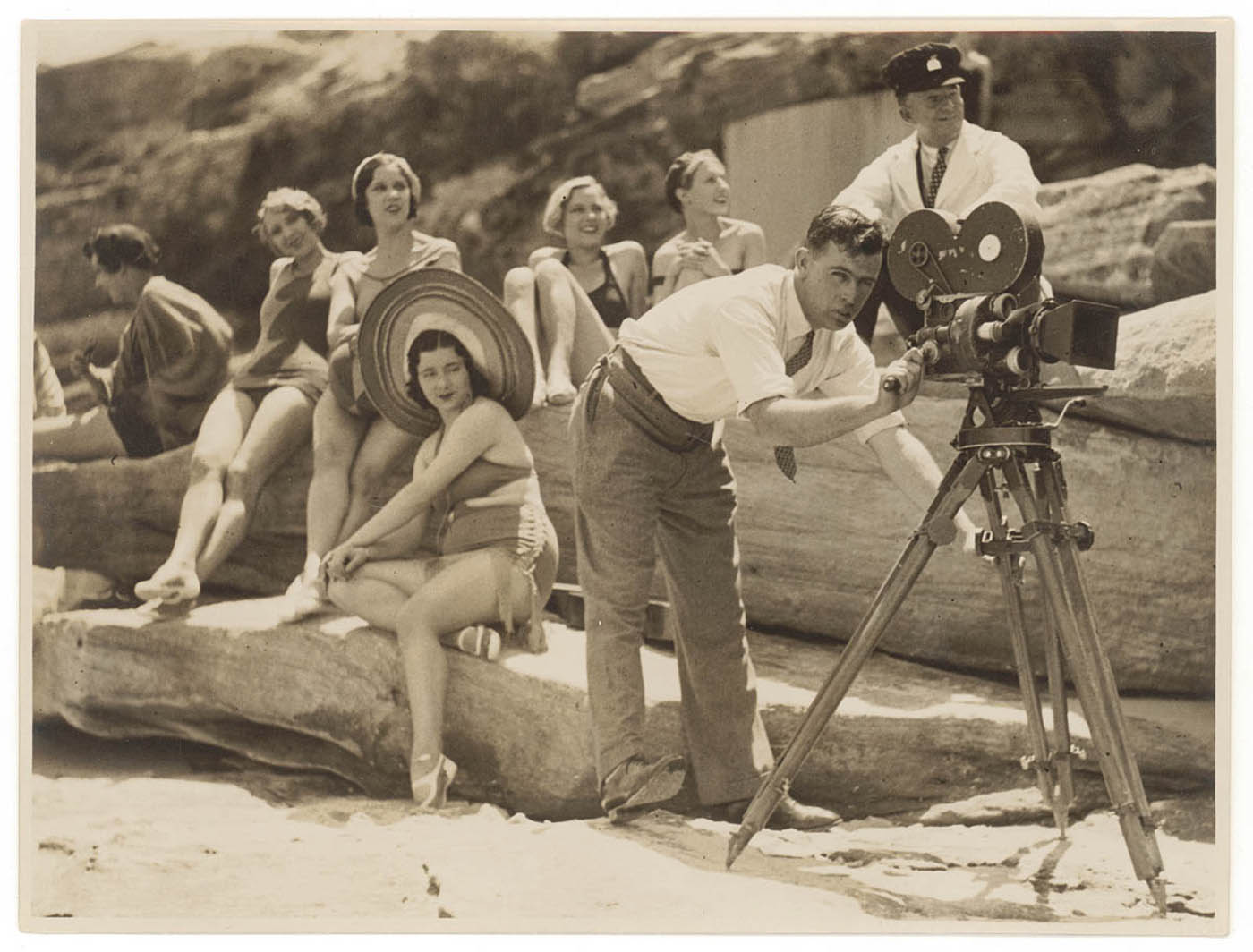 Men and women at the beach, filming with a hand wound camera, New South Wales, ca. 1935, Sam Hood