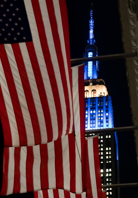 The American Flag with Empire State building in the background