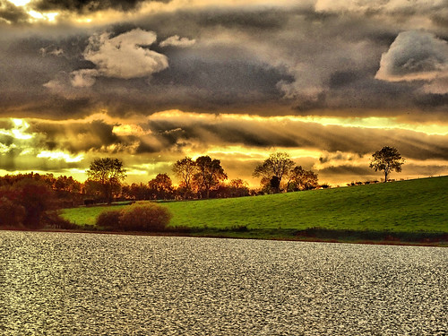 sunset and dark clouds over kernan lake near gilford codown