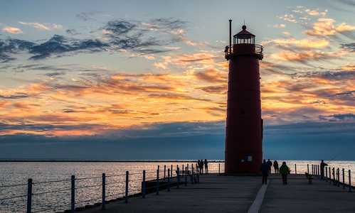 hdr hff lakemichigan michigan muskegon muskegonlighthouse nikon nikond5300 outdoor people clouds evening fence geotagged lake lighthouse pier sky sunset water silhouette silhouettes