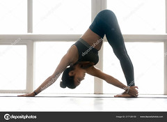 Young sporty woman practicing yoga, doing One Sided Fold exercis