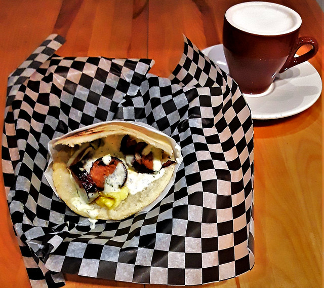Arepa, with scrambled egg, chorizo, cilantro mayo, feta; marrón (strong espresso with steamed milk)