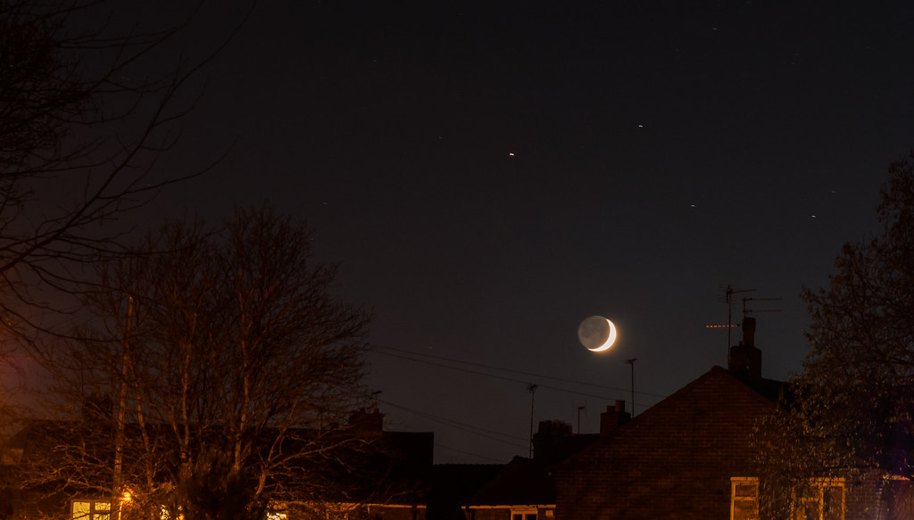 Waxing crescent Moon and Saturn conjunction.