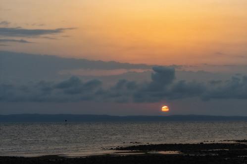 sky sunsetsandsunrisesgold sea sunrise sun cloudsstormssunsetssunrises clouds