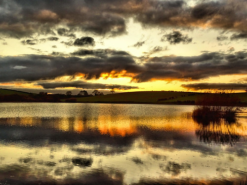 sunset and black clouds over kernan gilford co down
