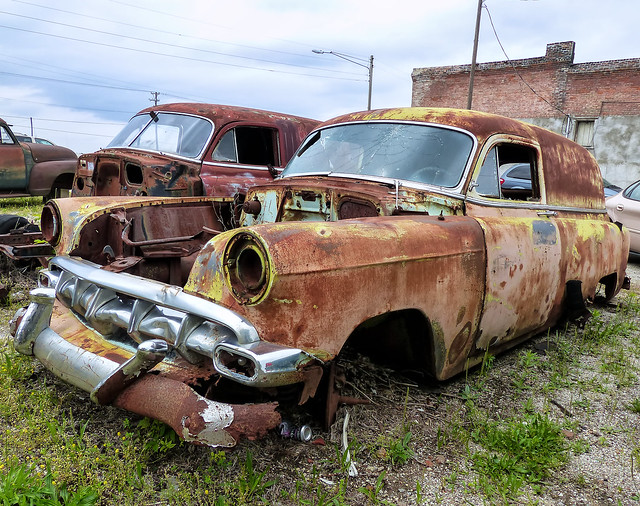 Two Rusty Chevrolet Sedan Delivery Panel Vans