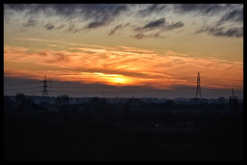 saxilby uk england lincolnshire sunset sun colour landscape orange pylon mist