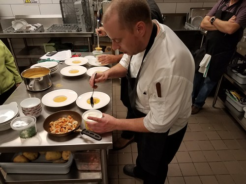 Chef Eli teaching how to plate shrimp bisque. From 5 reasons you should take a cooking class while traveling
