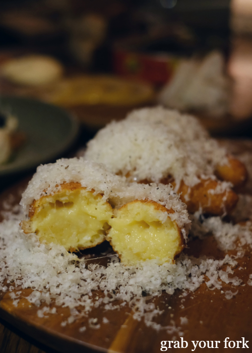 Inside the gruyere cheese donuts at The Kittyhawk in Sydney