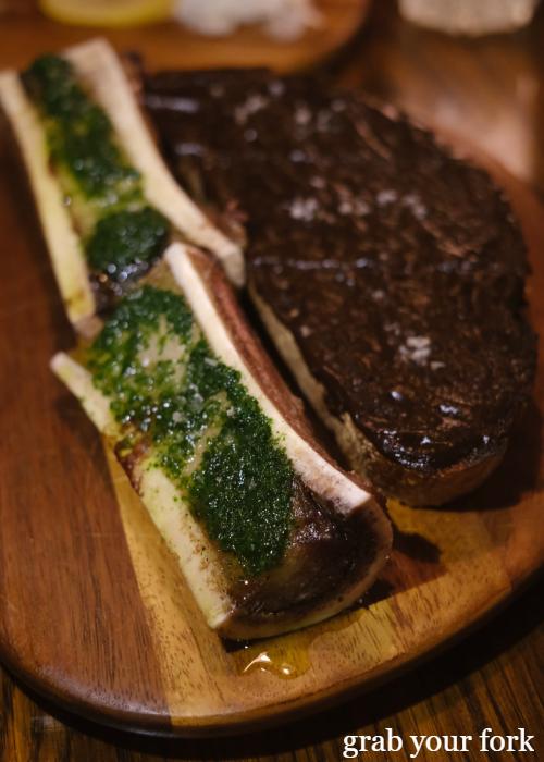 Bone marrow, parsley and black garlic toast at The Kittyhawk in Sydney
