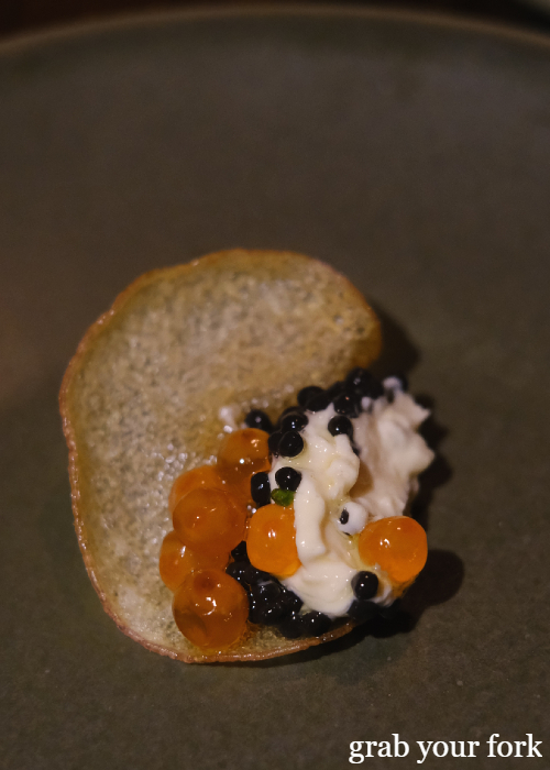 Potato crisp with trout roe and caviar at The Kittyhawk in Sydney