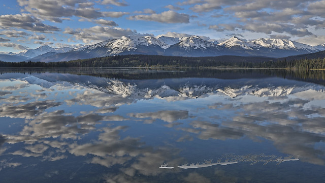Cotton clouds reflecting in Pyramid Lake.