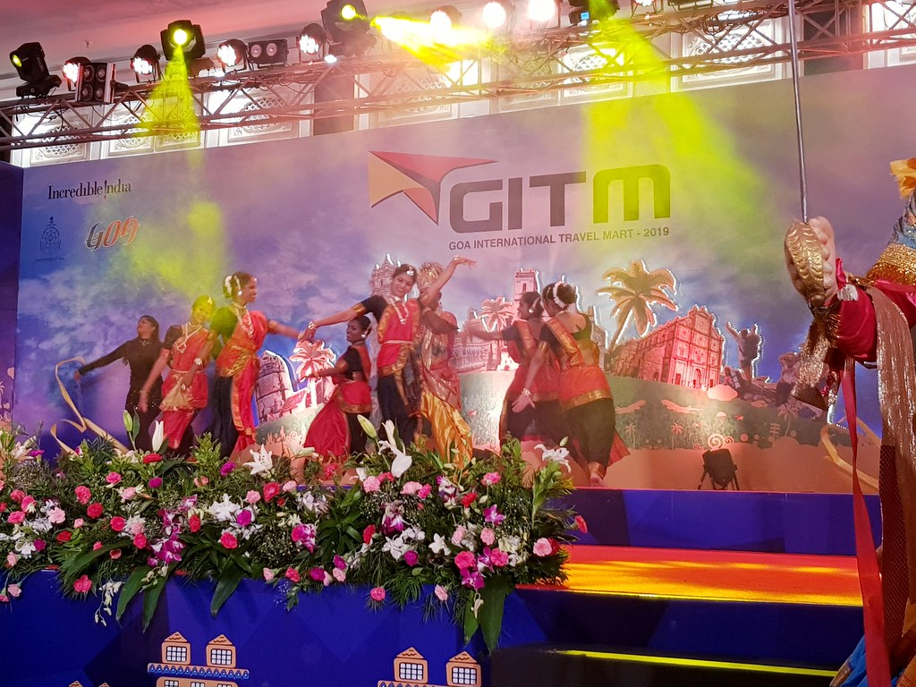 The opening ceremony of Goa Travel Mart, with traditional dancers dressed in red costumes performing a local dance.