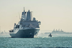 A Mark VI patrol boat escorts as USS New Orleans (LPD 18) transits out of San Diego in October. (U.S. Navy/BMC Nelson Doromal Jr.)