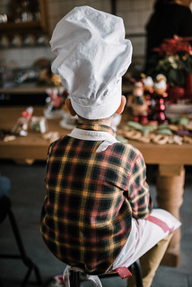 Young boy cook with cap sitting and  ready for cookie baking. Back view portrait. | by shixart1985