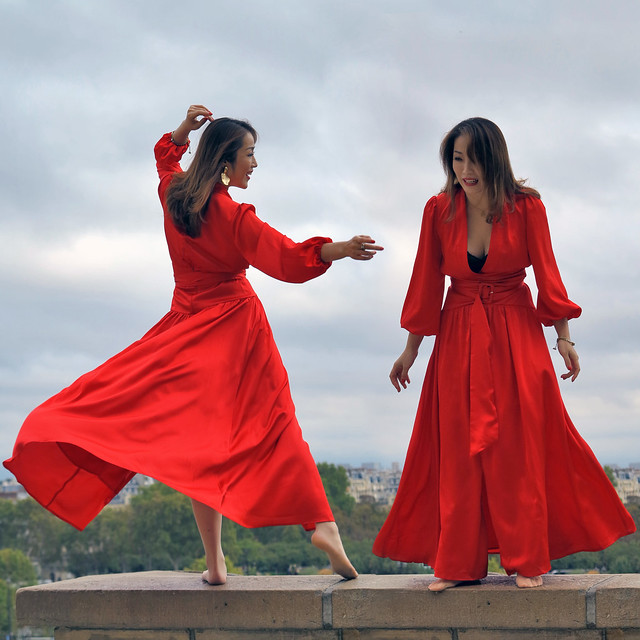 The barefoot Asian model dancing on the parapet