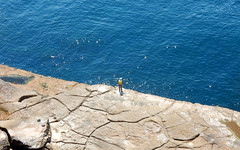 fisherman on sandstone