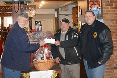 Presenting a cheque to Rob Merkley for the lights on the Dick Ready Christmas tree.