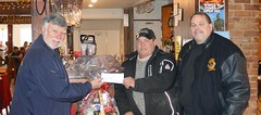 Presenting a cheque to Rob Merkley for the lights on the Dick Ready Christmas tree