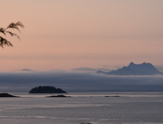 ISLANDS, MOUNTAINS AND JOHNSTONE STRAIT MAKES FOR A BEAUTIFUL SUNSET.   TELEGRAPH COVE,  BC