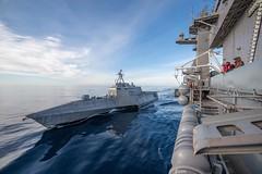 USS Omaha (LCS 12) pulls alongside USS Theodore Roosevelt (CVN 71) for a fueling at sea, Dec. 2. (U.S. Navy/MC3 Terence Deleon Guerrero)