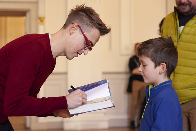 Tom Fletcher signs book for young fan: © Robin Mair