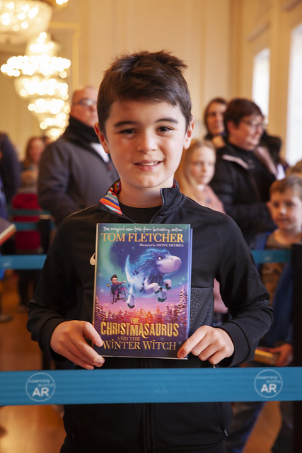 Tom Fletcher fan poses with book: © Robin Mair